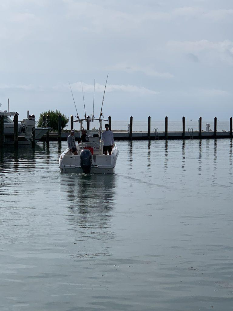 Boat in marina at Caloosa Cove.
